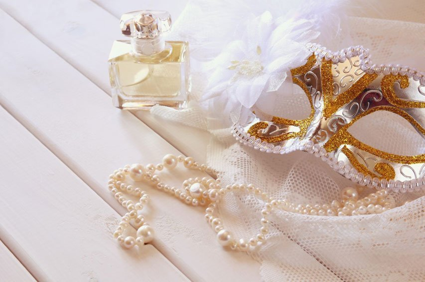 Gold mask, pearls and perfume